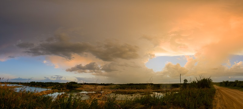 Storm over a quarry near Winnipeg, a few minutes later lightning was telling me to get out of there.