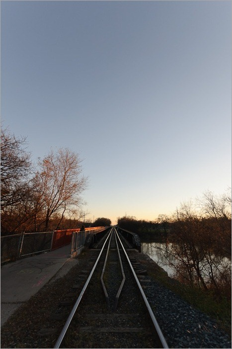 Wide view of a small railway bridge over the Assiniboine