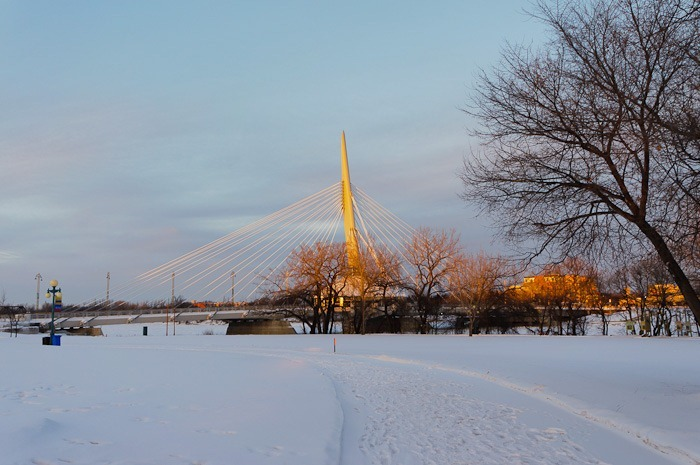 The Esplanade Riel, a burning arrow pointing upward